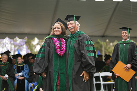 Brianna Miner, UC Irvine School of Medicine Class of 2017 graduate, receives her ceremonial hood from Dr. Mauel Porto.